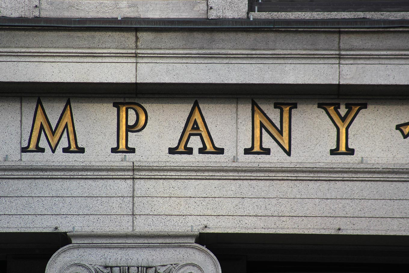 Detail of the inscribed lettering on the facade of the Canada Cement Company Building at 606, rue Cathcart
