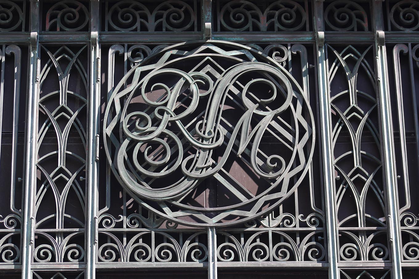 Wrought-iron monogrammed window grill on what was Simpsons Department Store (now Simons) on the rue Ste-Catherine.