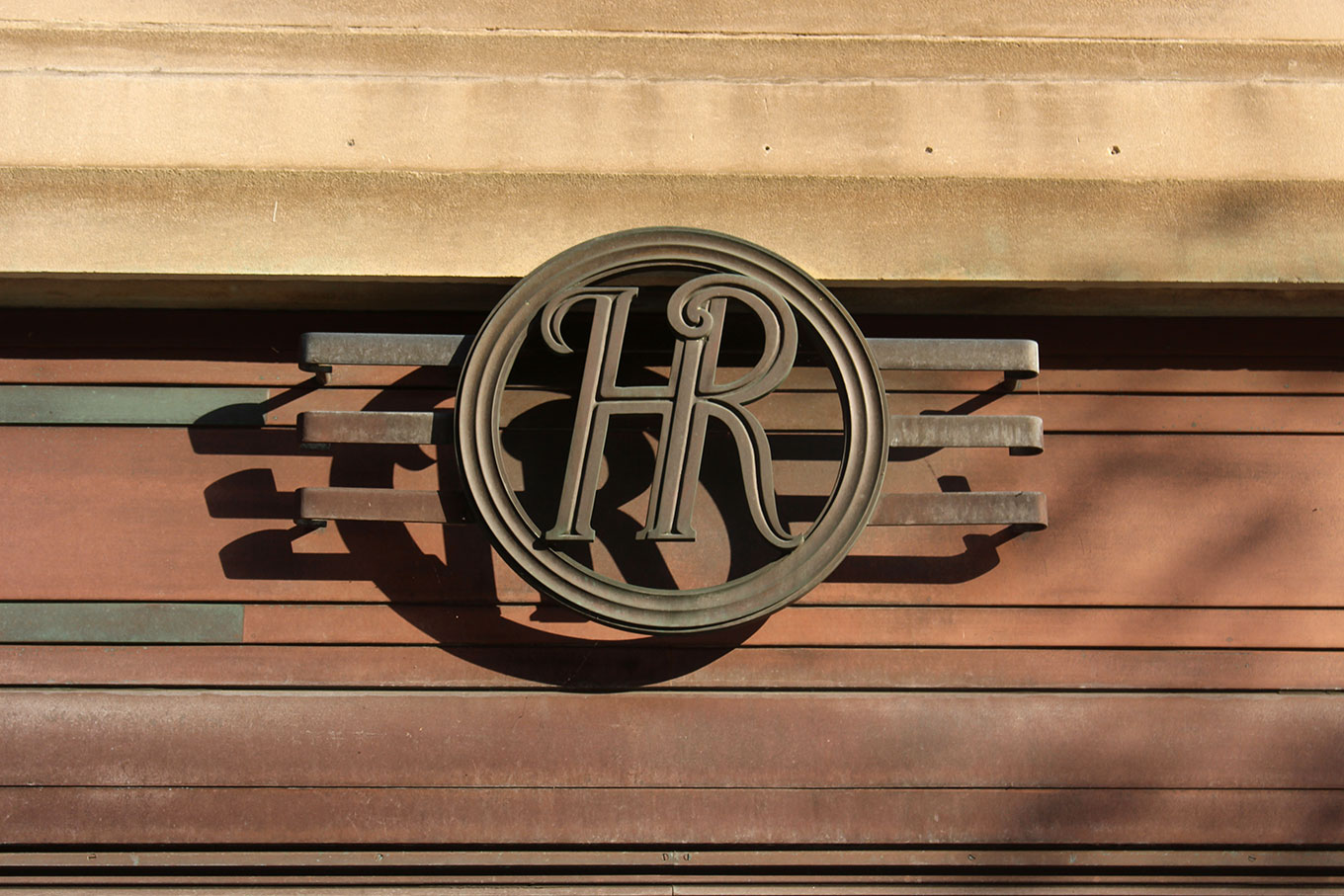 Monogram above the door of the Holt Renfrew Building on Sherbrooke Street West.