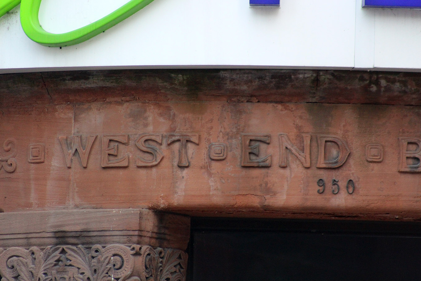 Detail of the original West End Branch lettering at the former Bank of Montreal (now Telus).
