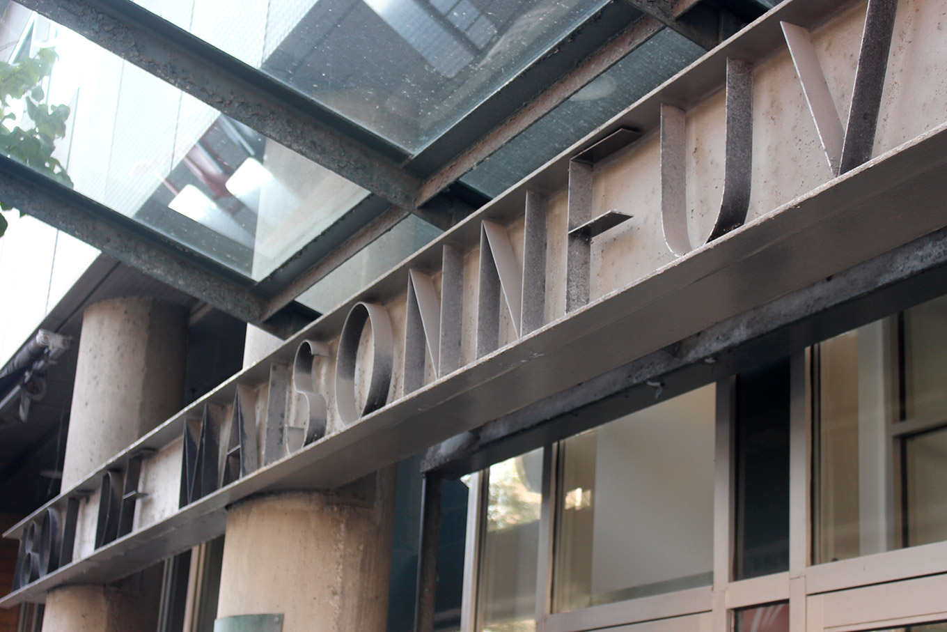 Fabricated stainless letters on the facade of a 1990s office building 1801 boulevard de Maisonneuve Ouest.